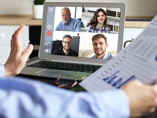 image of a person on a video conference call with four people