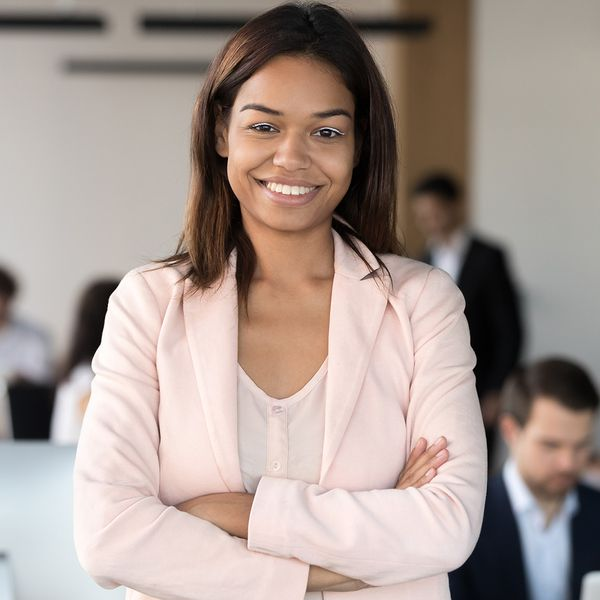 image of a business woman smiling with arms crossed