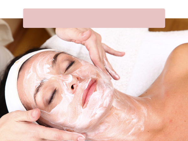 Close-up-of-a-woman-getting-an-exfoliating-facial-spa-treatment..png