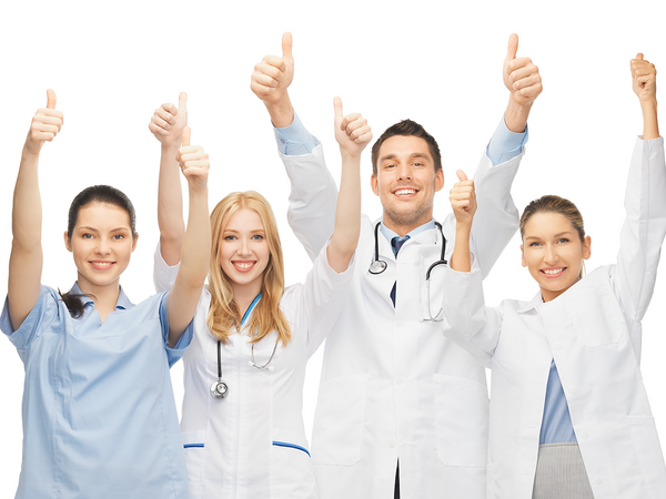 A group of doctors putting two thumbs up in the air and smiling.