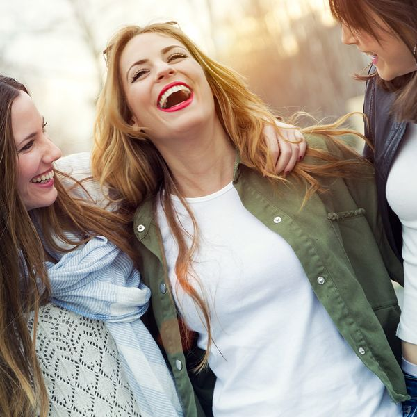 Group of young women laughing and talking.