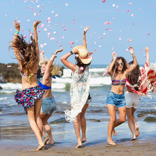 Group of young women having fun on the beach.