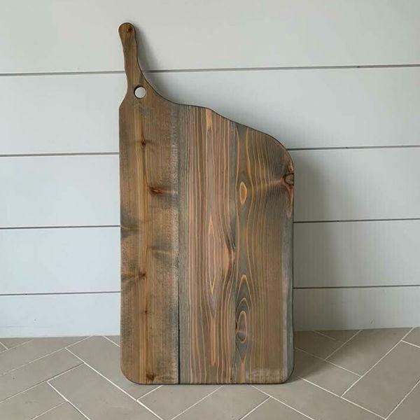 A custom-made brown charcuterie board.