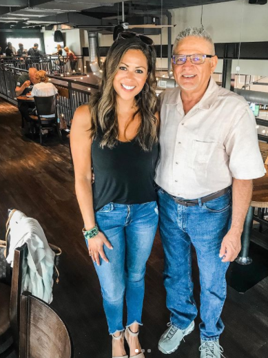 Pompo and his daughter are pictured together.
