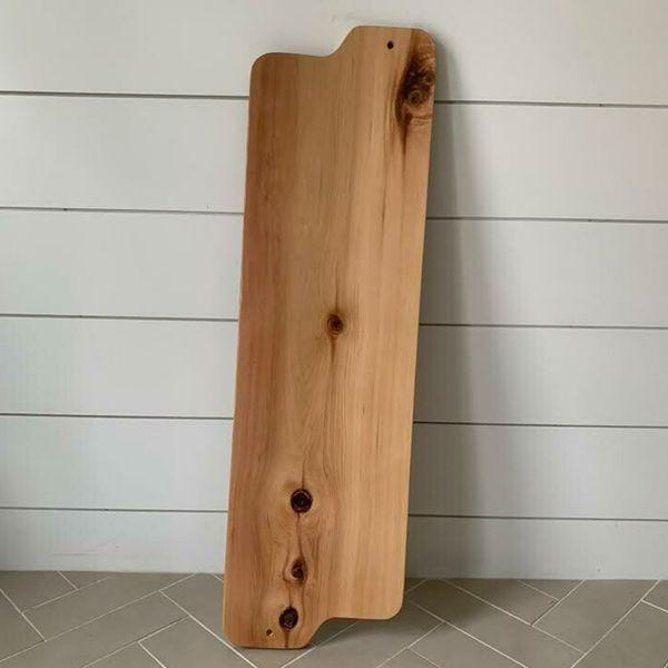 A long, wooden, custom bathtub board.