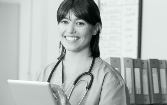 Happy female doctor with clipboard