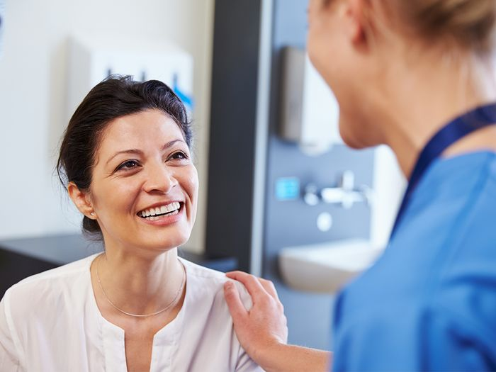Woman talking to doctors.
