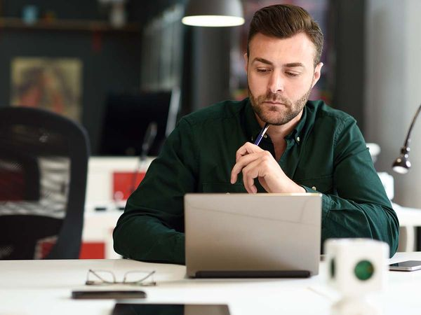 young professional man using computer