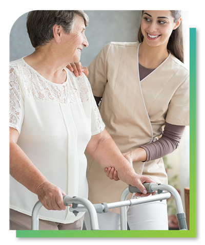 Image of a caregiver walking with a resident