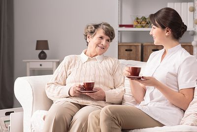 A happy resident with her caregiver