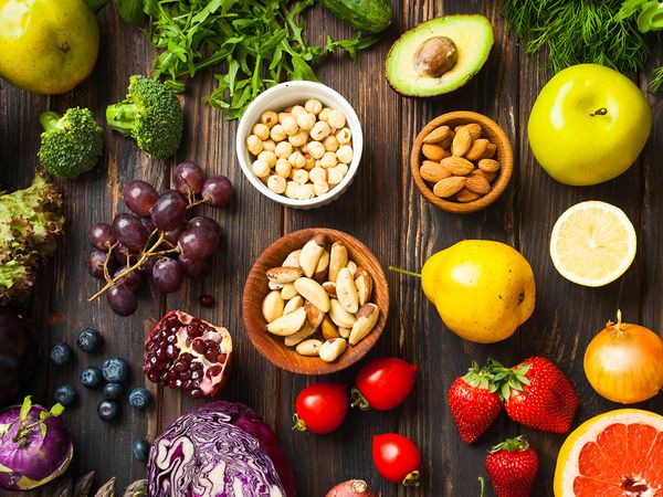 Colorful fruits and vegetables against a wooden backdrop