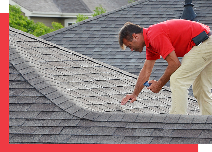 Image of a man inspecting a roof