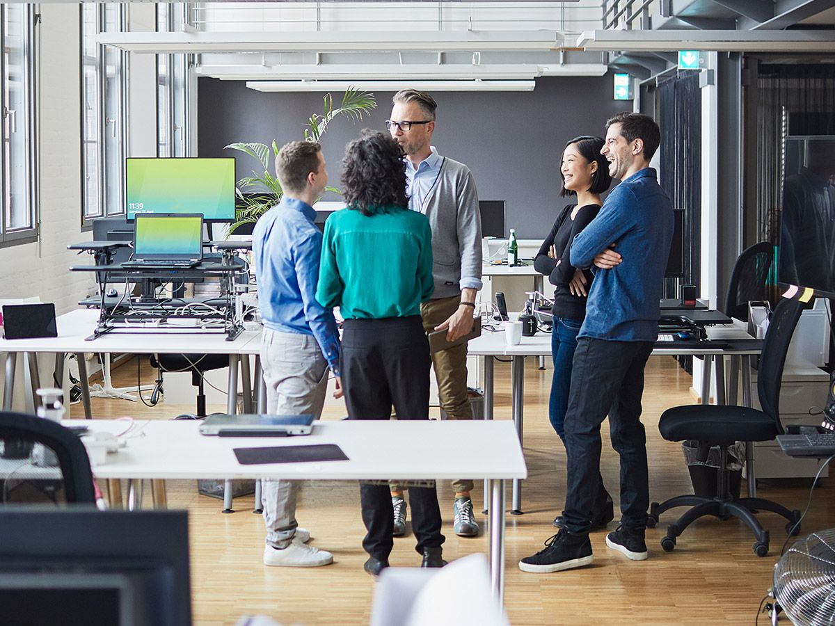 People standing around and chatting in an office