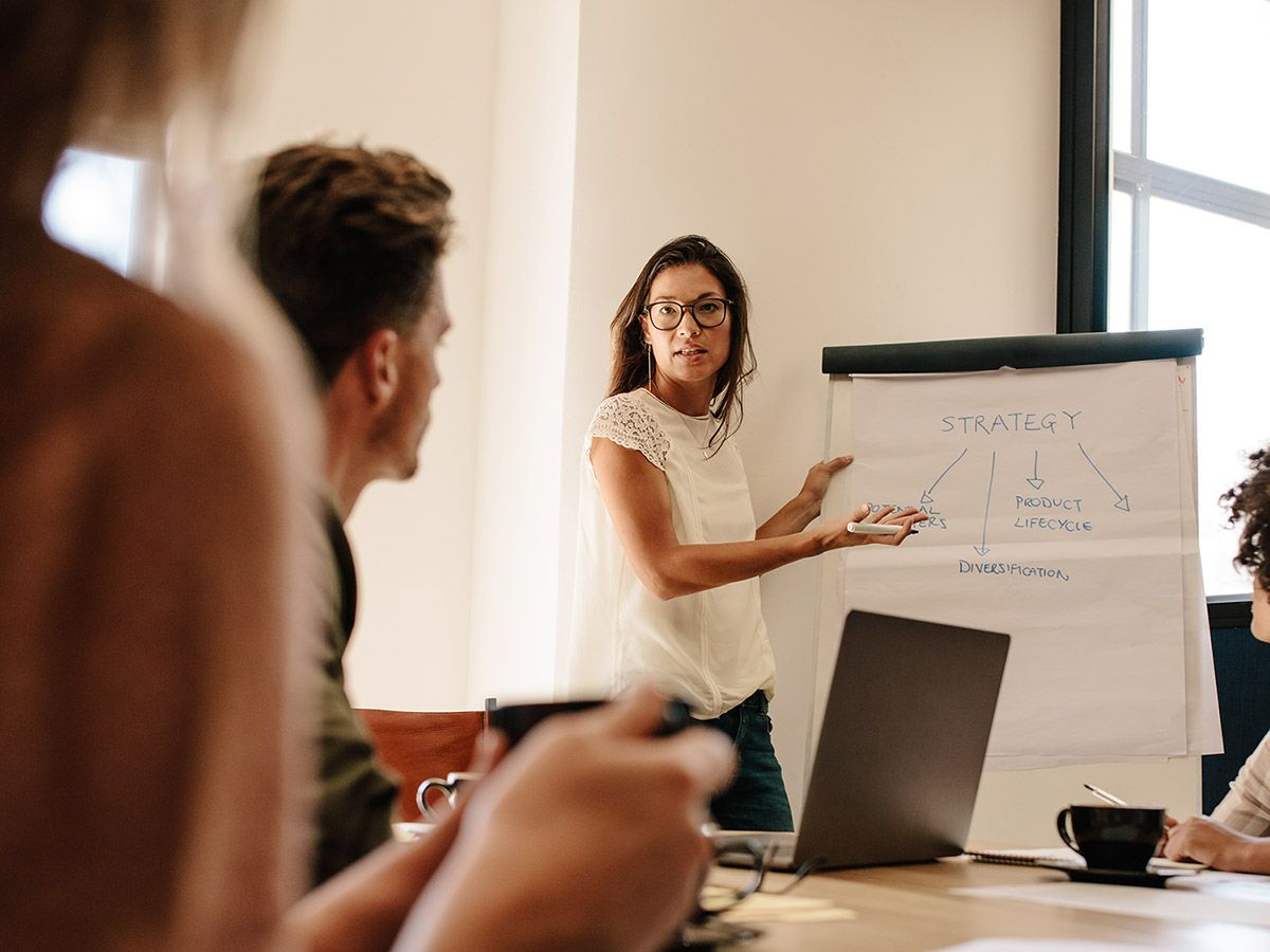 Woman giving a presentation to a team