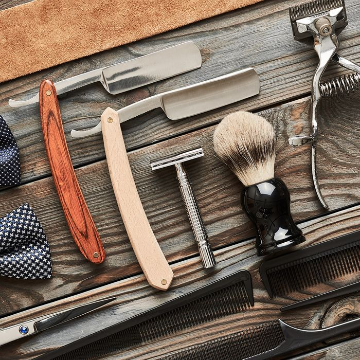 An array of vintage barbershop tools.