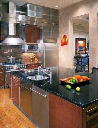 Image of a nice kitchen with a metal hood over the stove