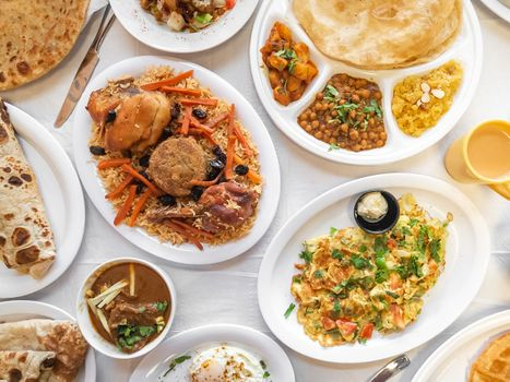 Table full of authentic Pakistani breakfast items.