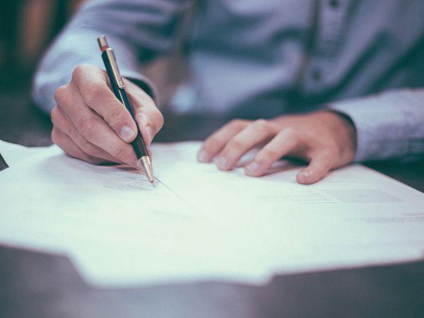 Man signing forms
