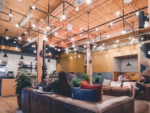 Customers enjoying an open communal space in a business