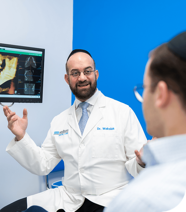 Dr.  David Wakslak explains dental imaging to patient