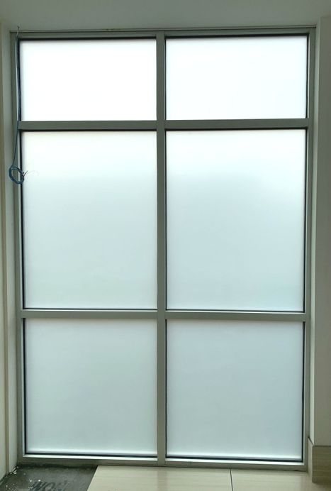 Installation of frosted window film.