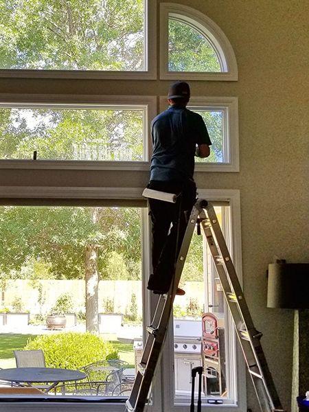 person adding window tint