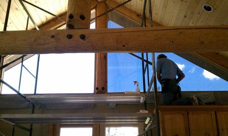 Installing Window Tint On Home Upper Window