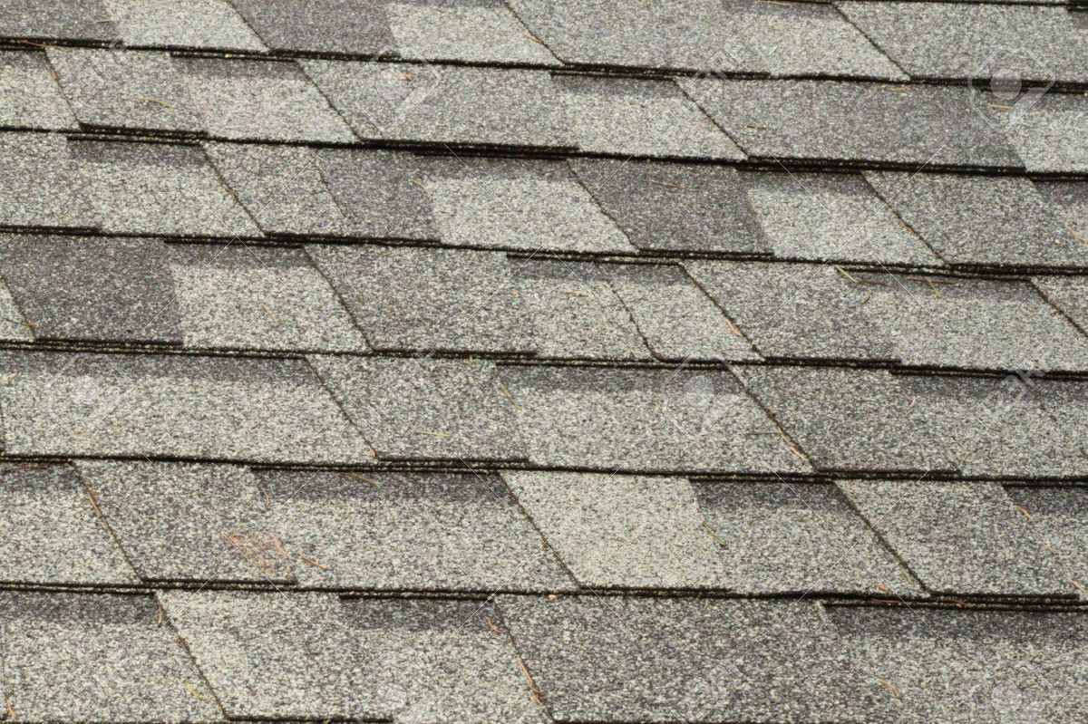 22496354-brand-new-roof-shingles.jpg