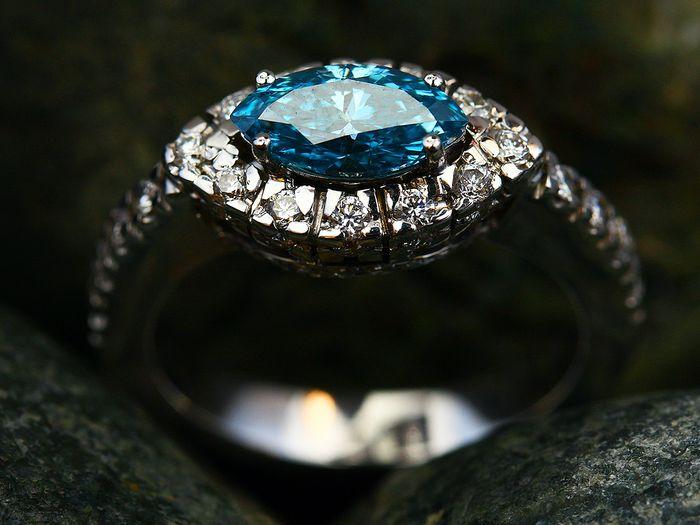 Blue sapphire ring with diamond halo
