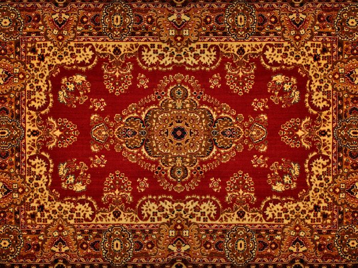 A standalone shot of a handcrafted antique rug.