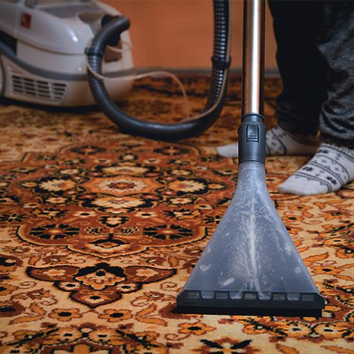 antique oriental rug being cleaned