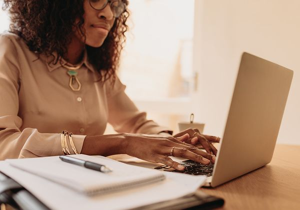 woman using laptop in office space