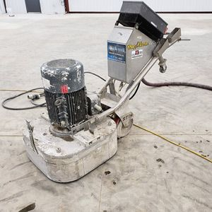 machine on concrete for coating