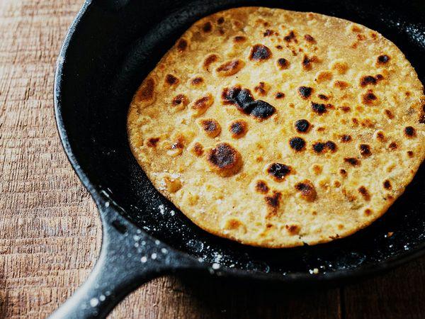Homemade Jamaican roti flatbread in a pan.