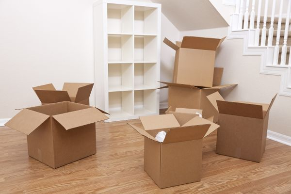 An image of an empty room with several cardboard boxes on the floor