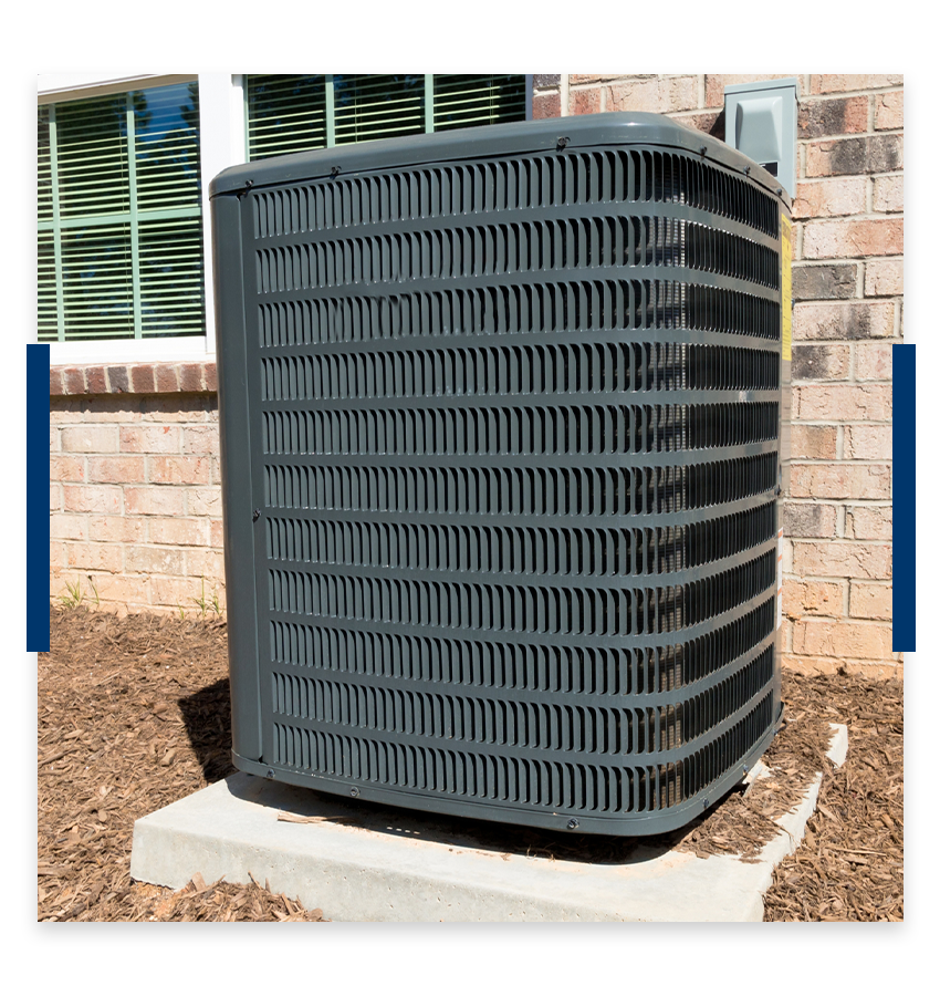 Air conditioner outside of a brick home.