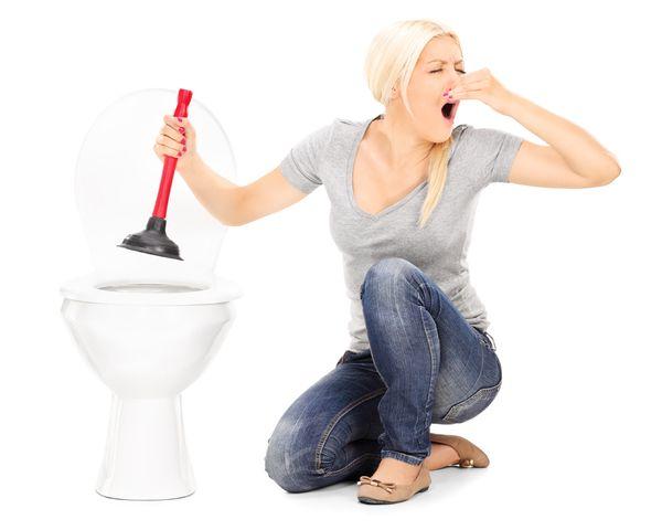 Woman Plumbing Toilet