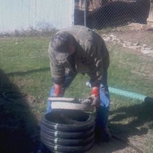 Septic Specialist Removing Tank Cover