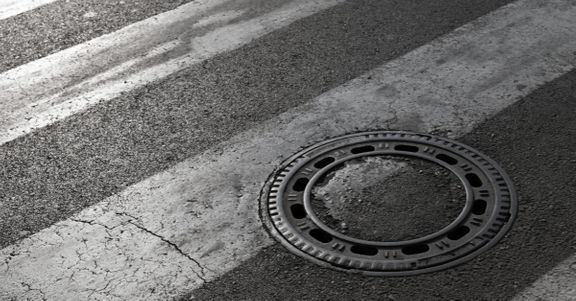 Manhole Cover on Street