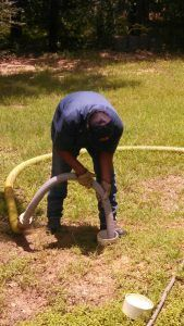Performing Septic Tank Pumping Service