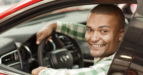 Image of a man driving a car
