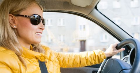 Image of a woman driving a car