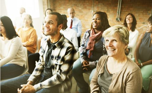 Image of a group of adults listening to a speaker