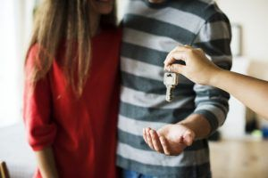 Image of someone handing over keys