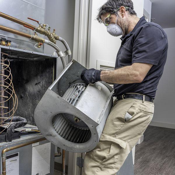 HVAC technician installing air filter