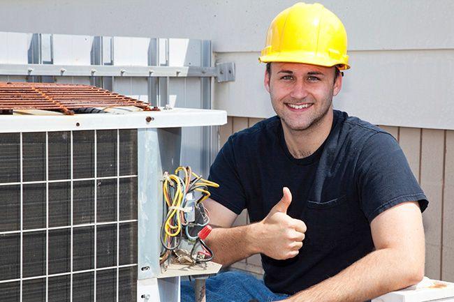 AC repair man giving a thumbs up
