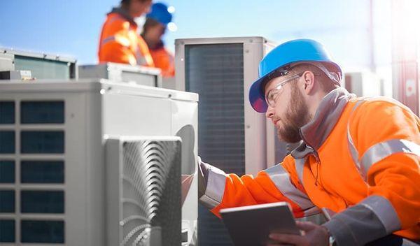 HVAC repairman working on AC unit