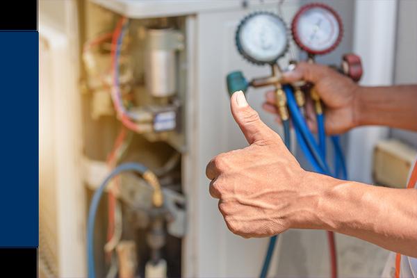 AC repairman inspecting unit
