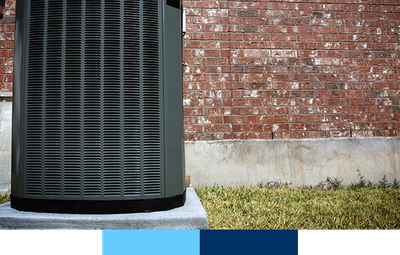 Air conditioner in front of brick wall.