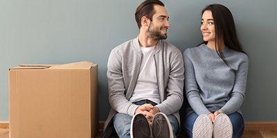 couple sitting next to box